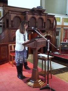 Alina sharing her story before being baptised